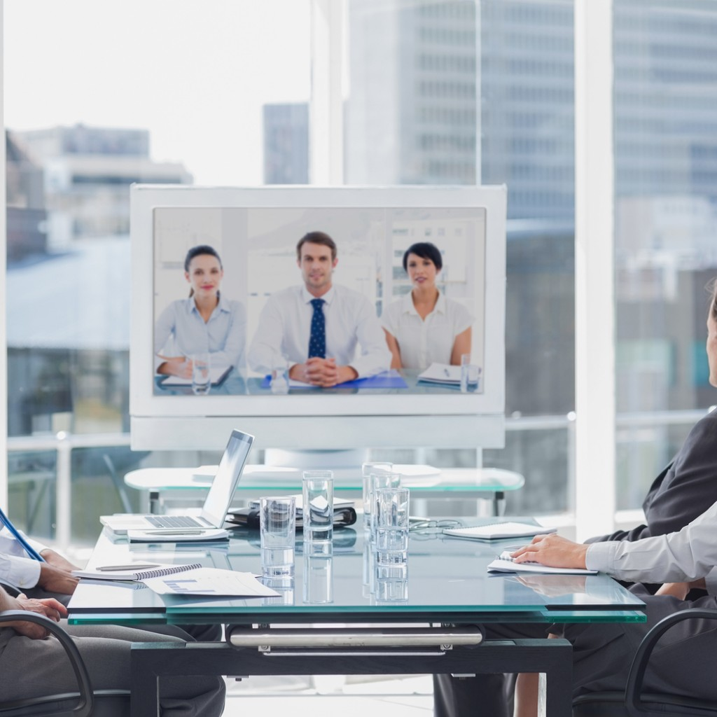 Business team having video conference with another business team